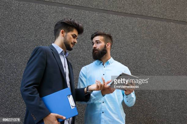 Two businessman looking at a preview of their plan