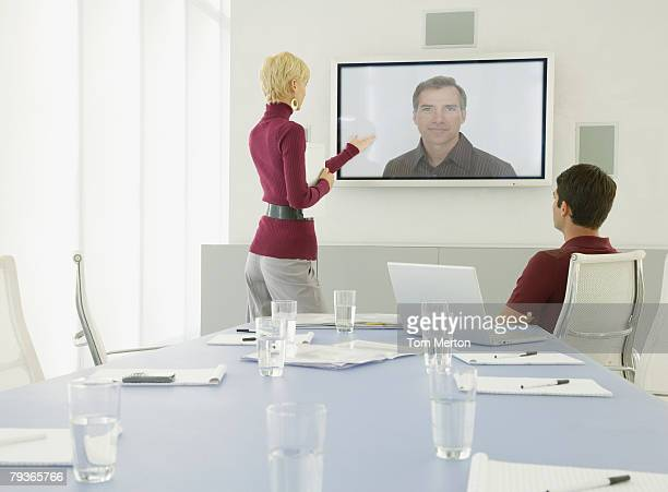 Two Businessmen and businesswoman having a video conference