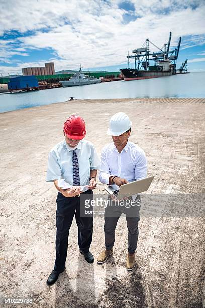Two businessmen At Commercial Dock