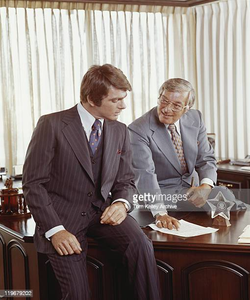two businessmen at desk looking at document - archival stock pictures, royalty-free photos & images