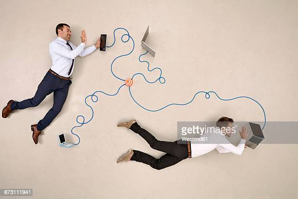 two businessmen being connected via mobile devices, waving - hovering stock pictures, royalty-free photos & images