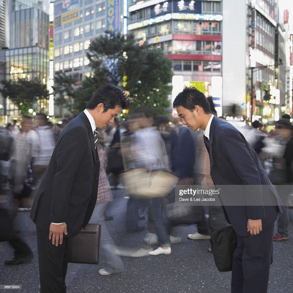 Two businessmen bowing : Stock Photo