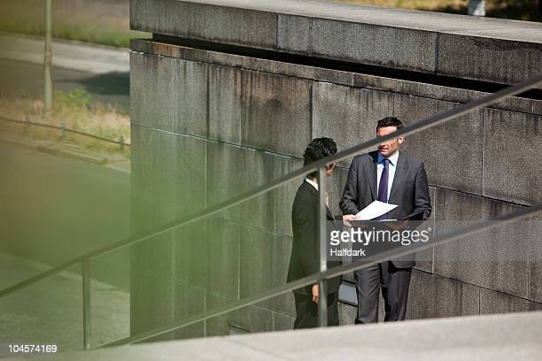 two businessmen conducting suspicious business - corruption stock pictures, royalty-free photos & images