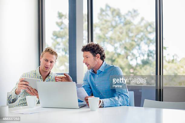 Two businessmen discussing a project