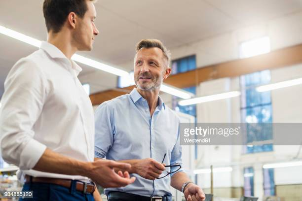 Two businessmen discussing in factory