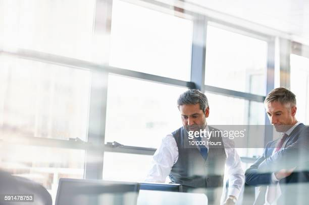 two businessmen discussing strategy in office - full suit stock pictures, royalty-free photos & images