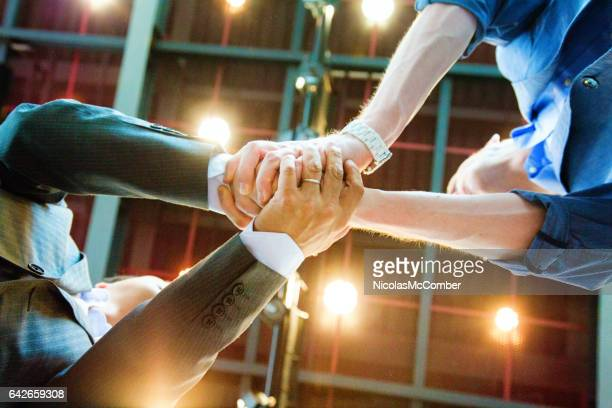 two businessmen double shaking hands from below - humility stock pictures, royalty-free photos & images