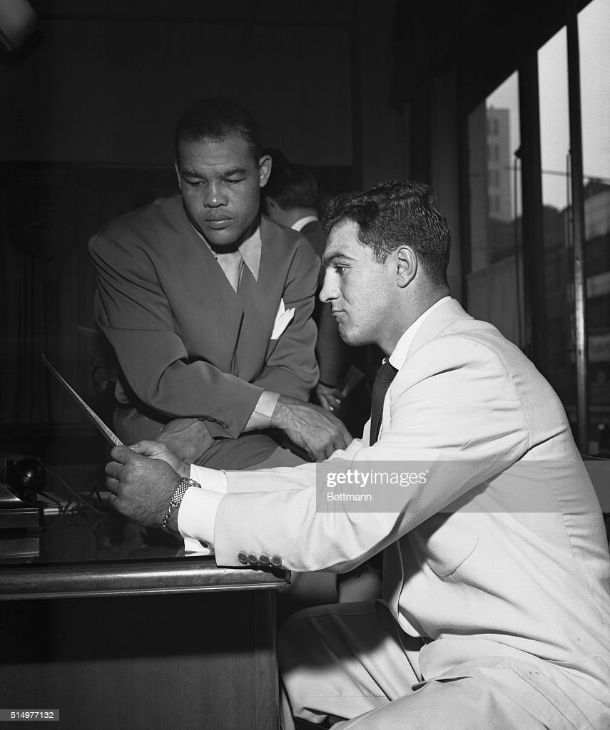 Joe louis and rocky marciano reading papers pictures getty images two businessmen draw up a contract new york joe louis left altavistaventures Gallery