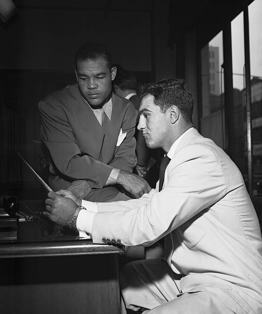 Joe louis and rocky marciano reading papers pictures getty images joe louis and rocky marciano reading papers altavistaventures