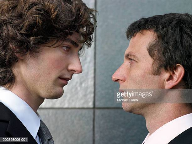 Two businessmen face to face, profile, close-up
