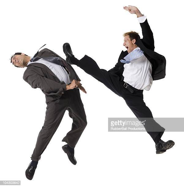 two businessmen fighting - kicking stock pictures, royalty-free photos & images