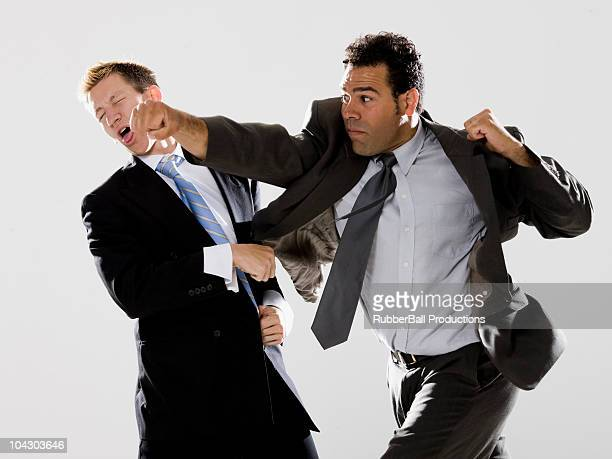 two businessmen fighting - punching stock pictures, royalty-free photos & images