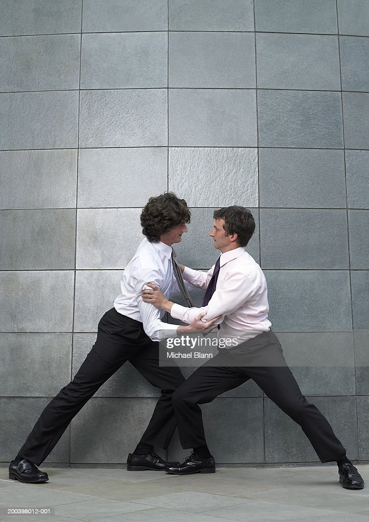 Two businessmen fighting, side view : Stock Photo