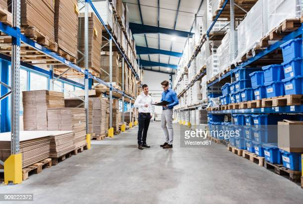 two businessmen having a meeting in company warehouse - checklist stock pictures, royalty-free photos & images