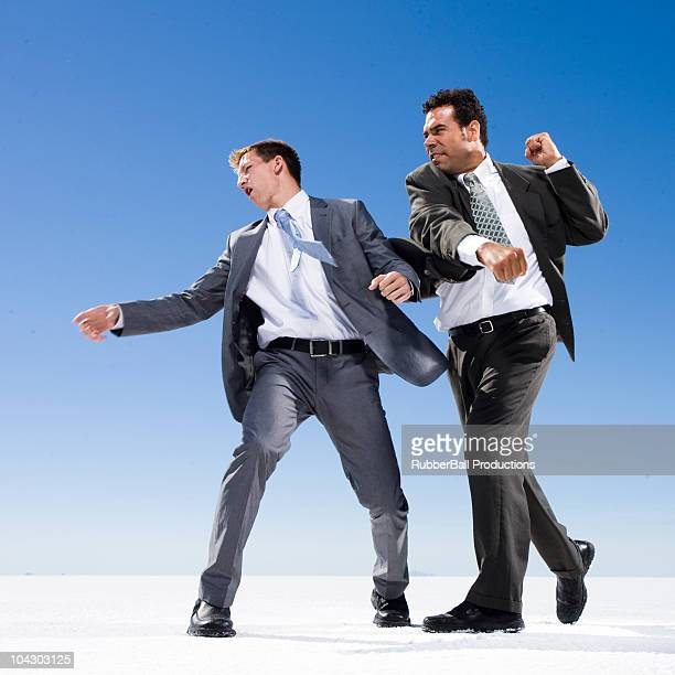 two businessmen in a fist fight