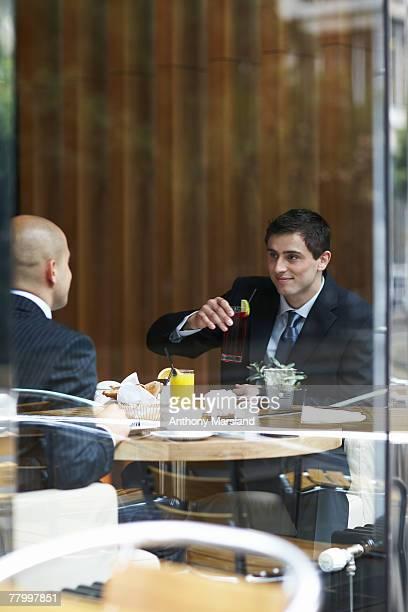 Two businessmen in a restaurant