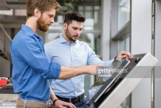 two businessmen in company using touchscreen - touch sensitive stock pictures, royalty-free photos & images