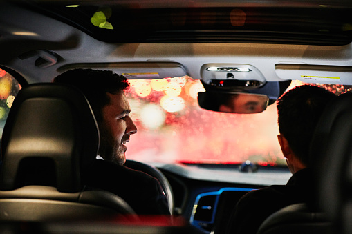 Two businessmen in discussion in car while waiting in rush hour traffic - gettyimageskorea