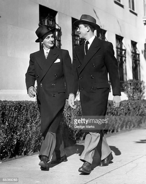 Two businessmen in jackets walking down