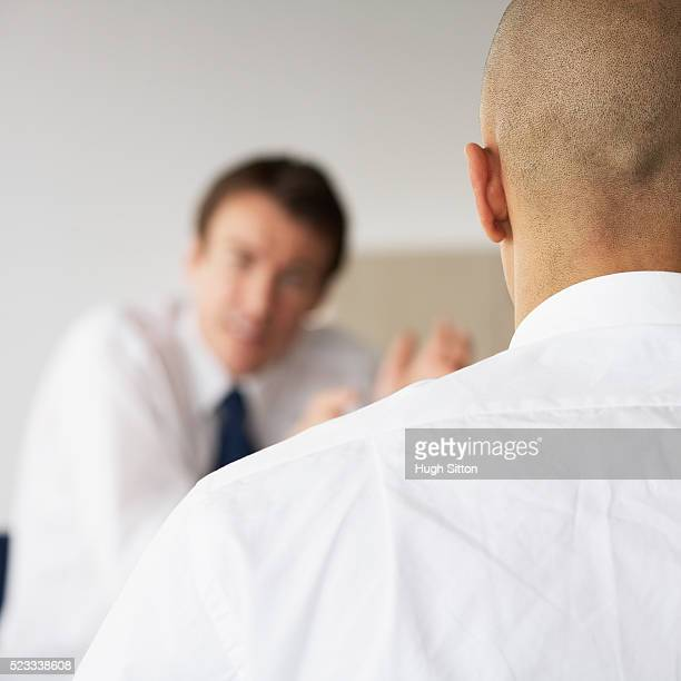 two businessmen in meeting - hugh sitton stock pictures, royalty-free photos & images
