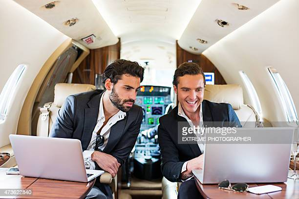 Two businessmen in private airplane