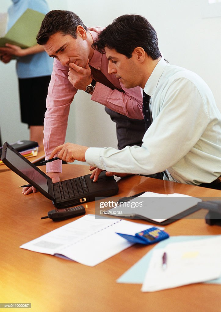 Two businessmen looking at laptop computer : Stockfoto