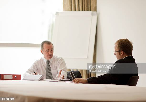 Two businessmen meeting in conference room