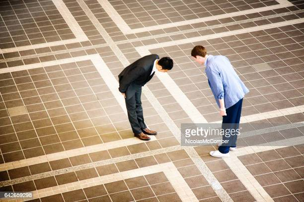 Two businessmen meeting in Japan and bowing