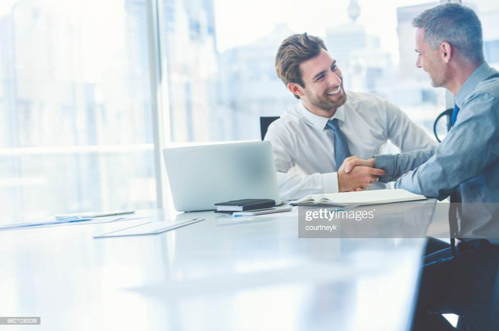 Two businessmen meeting with technology. : Stock Photo