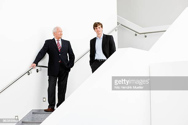 two businessmen on staircase