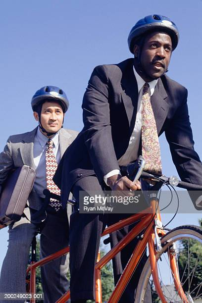 Two businessmen on tandem bicycle
