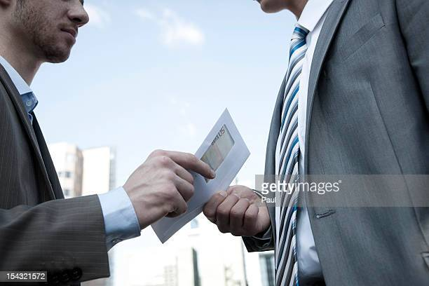 two businessmen - bestechung stock-fotos und bilder