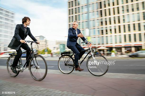 Two Businessmen Riding on Bicycles