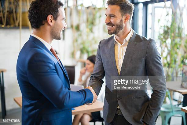 Two businessmen shaking hands after job well done