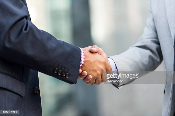 two businessmen shaking hands - gripping stock pictures, royalty-free photos & images