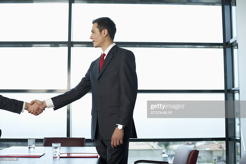 Two businessmen shaking hands : Photo