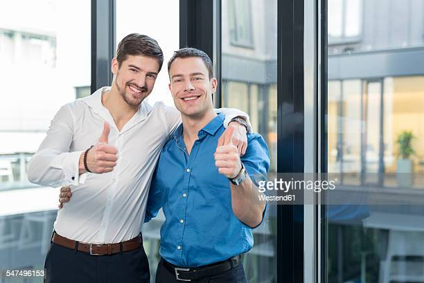 Two businessmen side by side in an office