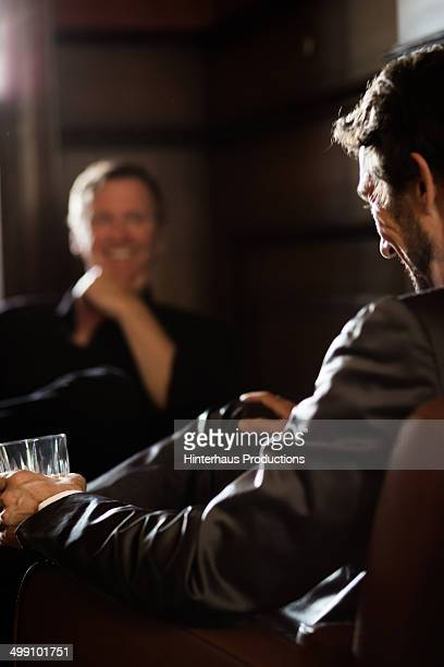 Two Businessmen sitting in a bar