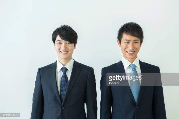 Two businessmen smiling