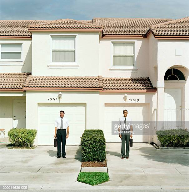 two businessmen standing outside houses - repetition stock pictures, royalty-free photos & images