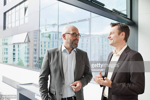 Two businessmen talking in office