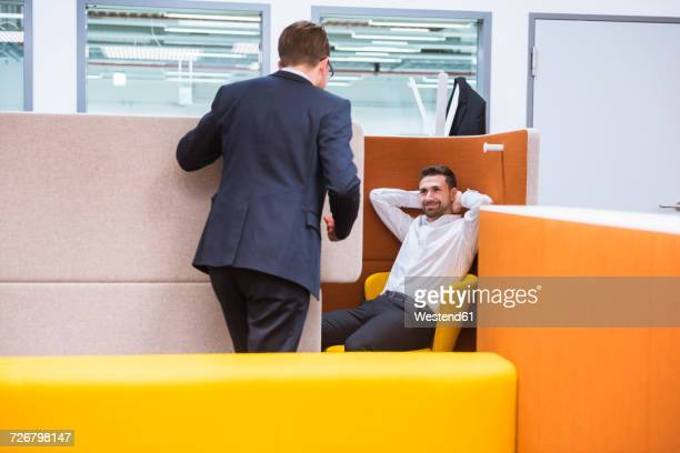 two businessmen talking in office - rumor stock pictures, royalty-free photos & images