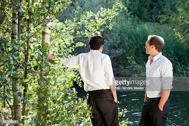 two businessmen talking on lakefront
