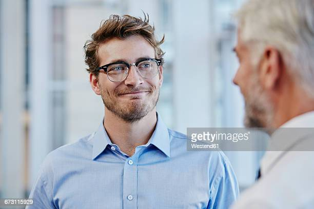 two businessmen talking together - truth be told stock photos and pictures