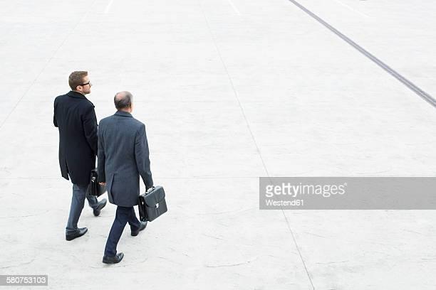 Two businessmen walking outdoors