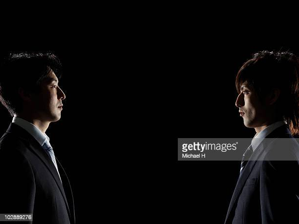 Two businessmen who stare