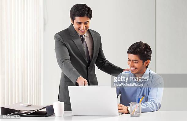 Two businessmen working together in office