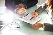 Two Businesspeople Analyzing Document