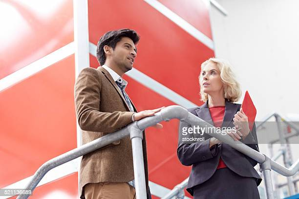 Two businesspeople discussing business