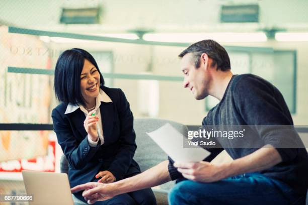 Two businesspeople discussing ideas